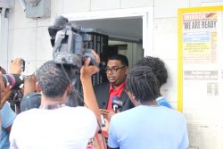 Irfaan Ali speaks to reporters yesterday after being elected as the PPP's presidential candidate for the next elections by the party's Central Committee. (Photo by Terrence Thompson)