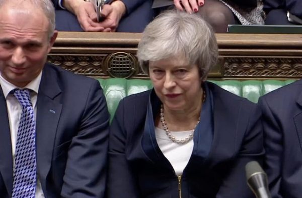 Prime Minister Theresa May sits down in Parliament after the vote on May's Brexit deal, in London, Britain, January 15, 2019 in this screengrab taken from video. Reuters TV via REUTERSReuters