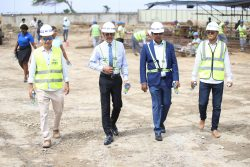 Representatives of CHEC guide Minister of Business Dominic Gaskin (second from left) and proprietor of the Pegasus Hotel,  Robert Badal (second from right) on a tour of the construction site of Pegaus Apartments and Corporate Suites.