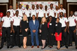 The West Indies one-day team pose with officials of Colonial Group International.
