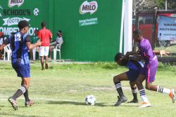 Action between Cummings Lodge and Uitvlugt in the Milo Secondary Schools Football Championships at the Ministry of Education ground, Carifesta Avenue, yesterday.