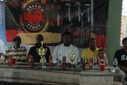 The members of the launch party for the inaugural Dragon Stout and I-Cool sponsored 'Dominoes in the Country' Championship from left to right Leroy Chilcott, Senior Organising Secretary of the GDA Mark Wiltshire, Dragon Stout Brand Coordinator Jamal Baird, David Hunte of Good Times Sports Bar and Anand Bharat of V&V Variety Store