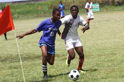 Action in the Milo Secondary School Football Championship between Ann's Grove and Friendship at the Ministry of Education ground, Carifesta Avenue yesterday