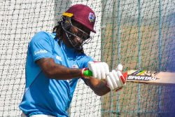 Left-hander Chris Gayle has a hit in the nets at Kensington Oval on Sunday.