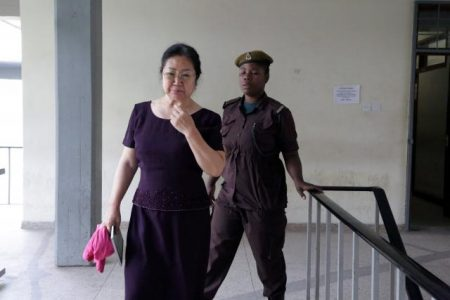 "Chinese businesswoman Yang Feng Glan, dubbed the ""Ivory Queen"", is escorted by a prison warden at the Kisutu Resident Magistrate Court in Dar es Salaam, Tanzania September 25, 2017. REUTERS/Stringer"