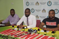 Director of Sports Christopher Jones [centre] addressing the gathering of media operatives on the 2nd NSC/Magnum Futsal Championship. Also in the photo are Magnum Brand Manager Edison Jefford [right] and tournament coordinator Esan Griffith