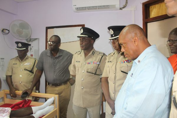 The police top brass visiting Constable Michael Grimmond (Police photo)