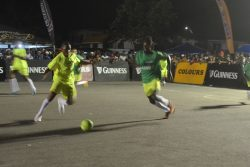 Flashback – Andrew Murray of Brothers United [dark green] and Jamal Hamilton of Ballers Empire and racing towards a loose ball during their semi-final clash at the Pouderoyen Tarmac in the Guinness 'Greatest of the Streets' West Demerara/East Bank Demerara Championship