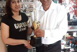 Trophy Stall's Devi Sunich hands over the sponsorship to LGC President Aleem Hussain for the 2019 tournament