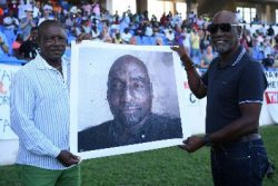 From one captain to another: Sir Vivian Richards (right) receives the portrait from Sir Richie Richardson at the Vivian Richards Cricket Ground.