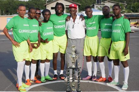 Brothers' United captain Adami Hoyte [third from right] posing with members of his squad at the official presentation ceremony and photo shoot for the Guinness 'Greatest of the Streets' West Demerara/East Bank Demerara Championship