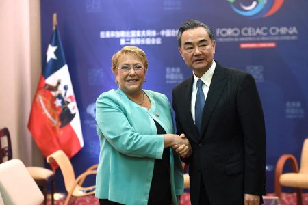Chile's president Michelle Bachelet and China's Foreign Minister Wang Yi meet at China and the Community of Latin American and Caribbean States (CELAC) Forum, in Santiago, Chile January 22, 2018. Ximena Navarro/Courtesy of ChileanPresidency/Handout via Reuters