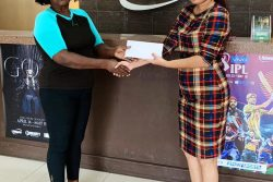 Guyana Committee of Service's Avril Black (left) receives the sponsorship from E-Networks Vanita Persaud.