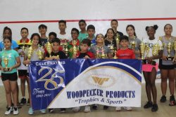 Winners of the 2019 Woodpecker Products Junior National Squash tournament pose with their spoils.