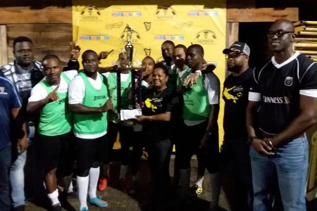THE GREATEST!Beacons Captain Whitney Welcome receives the championship trophy from Banks DIH Bartica Branch Manager, Amanda Murray while his team mates share  the moment. Also present are Guinness Brand Executive Lee Baptiste and Bartica District Sales Supervisor Keron Savory