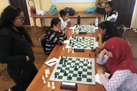 A section of the participants in the Women's National Chess Championship this month at the Racquet Centre, Woolford Avenue. The number of women contestants was infinitesimal, compounding the unambiguous message that we should get more schools securely involved in chess. (Photo by Rashad Hussein)