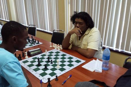 Anthony Drayton (left) and Taffin Khan during a previous encounter. The clash between the two could well determine a new national chess champion. If they play to a draw, and each has the identical number of points, the tie-break system would specify the winner.