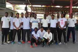 participants post for a photo at the conclusion of the GCA cricket development session yesterday.