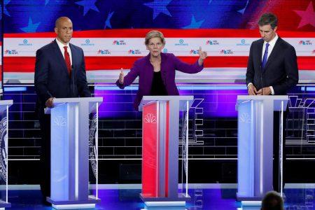 U.S. Senator Elizabeth Warren speaks as U.S. Senator Cory Booker (left) and former U.S. Rep. Beto O'Rourke listen at the first U.S. 2020 presidential election Democratic candidates debate in Miami, Florida, U.S., June 26, 2019. REUTERS/Mike Segar
