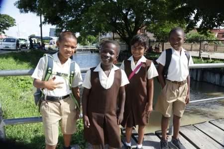 Pupils of Leonora Primary pose for a photo. From left are Delon, Jamesha, Darshanie and Leron