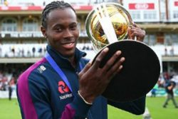 Jofra Archer poses with the World Cup trophy following England's win over New Zealand in last Sunday's final.
