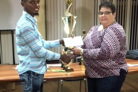 The 2019 National Chess Champions Anthony Drayton and Maria Varona-Thomas congratulate each other at the presentation of prizes for the National Championship at the Resource Centre. Drayton and Varona-Thomas played flawlessly during their individual encounters without conceding a game. (Photo: Irshad Mohamed)