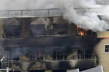An aerial view shows smoke and flame rise from the three-story Kyoto Animation building which was torched in Kyoto, western Japan, in this photo taken by Kyodo July 18, 2019. Mandatory credit Kyodo/via REUTERS