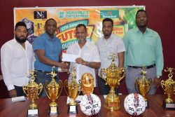 New Era Entertainment Co-Director Aubrey Major Jr [2nd from left] receives the sponsorship cheque from Managing Director of Mohamed's Enterprise, Nazar Mohamed in the presence of Kenrick Noel [left], Shareef Major [2nd from right] and Ansa McAl representative Jamal Baird [right].