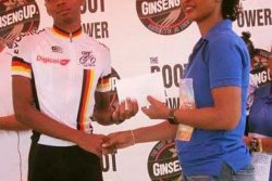 Flackback! Christopher Griffith receives his prize from the wife of the late Urban Benjamin.