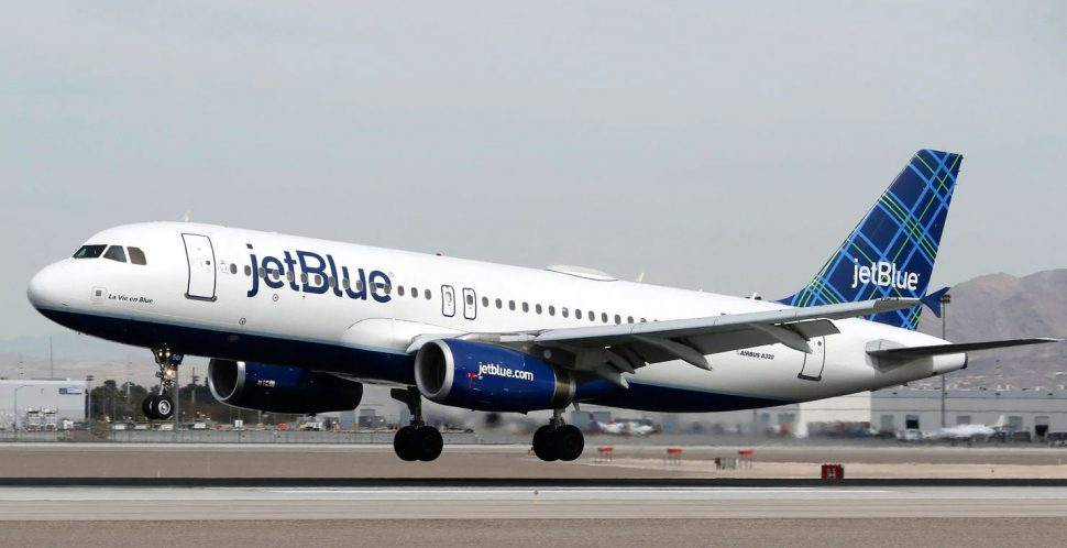 A Jetblue aircraft lands at a airport in the US.