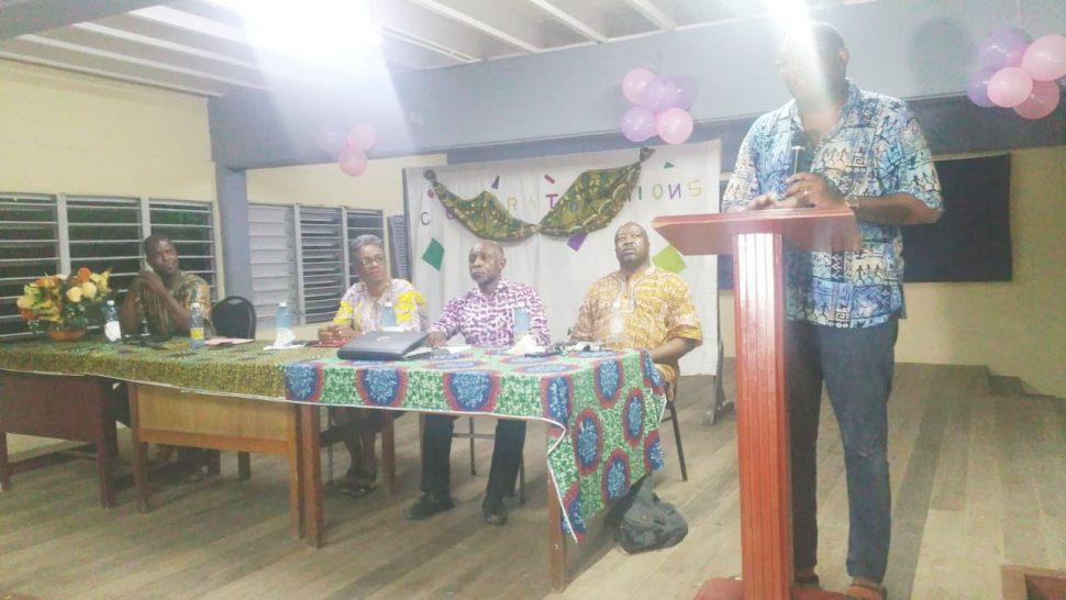 Nigel Hughes speaking yesterday. Seated from right are David Hinds and Carl Greenidge.