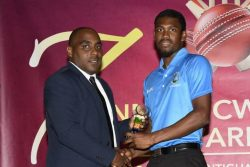 Keemo Paul receives his award for being adjudged the T20 International Player of the Year.