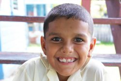 Parsram Budhu's great grandson poses in his Hope Estate Primary School uniform