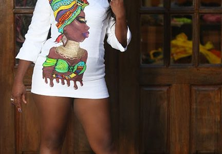 This model is decked out in a sassy short dress, fit for a night of clubbing. The African-inspired painting down the front gives it a unique finish.