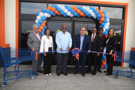 Minister of Finance Winston Jordan (third from left) and Chairman of Massy Integrated Retail Business Unit, David Affonso (centre), flanked by Massy Stores executives and Minister of Business Haimraj Rajkumar (third from right) as they cut the ribbons to officially open the Massy Stores Mega at the MovieTowne compound, Turkeyen. (Terrence Thompson photo)