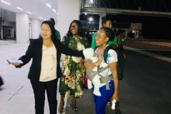 Minister of State Dawn Hastings (left) welcomes home Hurricane Dorian survivor Mrs Grimmond and her infant at the Cheddi Jagan International Airport, Timehri last night as Minister of Foreign Affairs Dr Karen Cummings looks on.