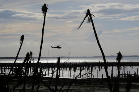 An unidentified helicopter lands to deliver food and water in the aftermath of Hurricane Dorian on the Great Abaco island town of Marsh Harbour, Bahamas, September 4, 2019. REUTERS/Dante Carrer/File Photo