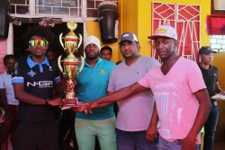 (l-r) Briton John receives his prize from Ojay Joseph of Jaggernauth Entertainment, Therbhuwan Jagdeo and Junior Williams of Club Fiesta.