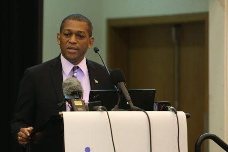 Dr Mark Bynoe delivering his address (Department of Public Information photo)