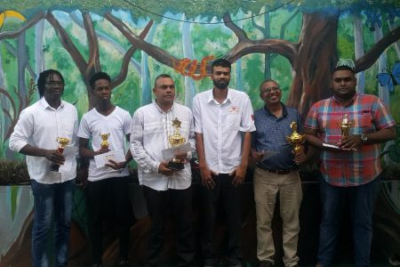 At the Berbice Chess Association's tournament on September 1, the winners were photographed with a representative of the sponsor A Ally and Sons. From left are: Frankie Farley, Darwin London, Kriskal Persaud (first prize), Chandradat 'Mike' Ramnarine (representative of the sponsor), Loris Nathoo and Jacob Nauth.