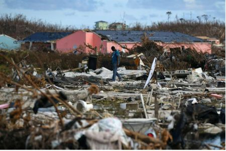 A man searches for belongings amongst debris in a destroyed neighborhood in the wake of Hurricane Dorian in Marsh Harbour, Great Abaco, Bahamas, September 8, 2019. REUTERS/Loren Elliott