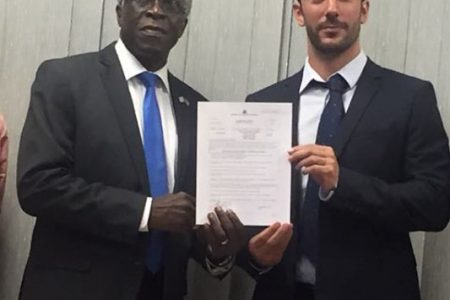 Director General of the GCAA Lieutenant Colonel (ret'd) Egbert Fields (left) handed over the first Helideck licence to Country Manager of TLC Guyana Inc, Mathieu Guiraud yesterday morning.