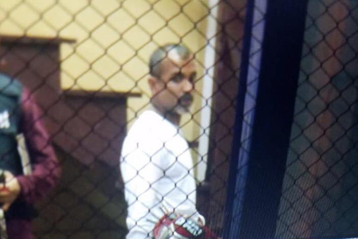 Roger Khan photographed while in police custody on Friday