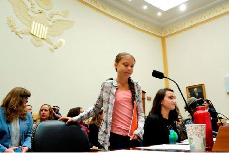 """Sixteen year-old Swedish climate activist Greta Thunberg takes her seat to testify at a House Foreign Affairs subcommittee and House Select Climate Crisis Committee joint hearing on """"Voices Leading the Next Generation on the Global Climate Crisis"""" on Capitol Hill in Washington U.S., September 18, 2019. REUTERS/Kevin Lamarque"""