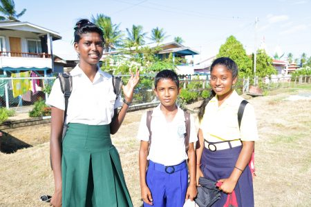 On their way home from schools: From left: Devayani Persaud of Fort Wellington Secondary School, Jason Bhuggoo (Number 8 Secondary) and Mohanie Siarjoon (Woodley Park Secondary)