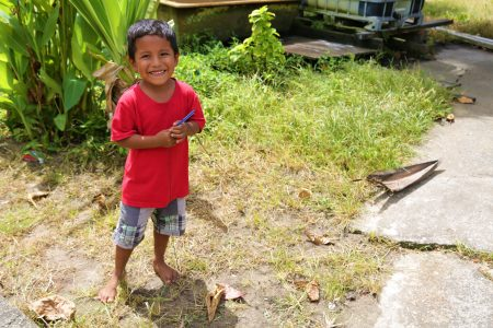 Six-year-old Blake Primary School student Mario Williams pulling his tree-branch boat around his yard