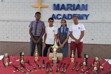 First place winners St Stanislaus College. From left are Jaden Taylor, Ghansham Alijohn, Chelsea Juma and Jorrel Troyer (Photo by John Lee)
