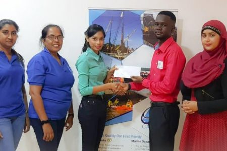 "Gaico Construction etched its name in the Grand Prix series of the Guyana Chess Federation (GCF) through a donation of $320,000 in prizes for four tournaments. Office Manager of Gaico Champa Maraj, in handing over the cheque, said: ""GAICO is a 100% Guyanese company and Managing Director Komal Singh is always in support of Guyanese activities which promote youth initiatives and harmony."" GCF Treasurer Davion Mars received the cheque and expressed his gratitude to Gaico for being the premier sponsor of the Grand Prix series. At the ceremony, Mars outlined the purpose of the four competitions."