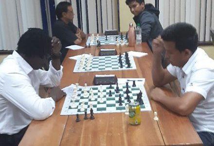 Guyana Chess Federation president Frankie Farley, left,  in his game against Justino Da Silva.