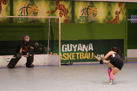Marzana Fiedtkou of GBTI GCC Tigers in the process of scoring from the penalty spot against Saints in the Women's Division of the GTT National Indoor Hockey Championship at the Cliff Anderson Sports Hall, Homestretch Avenue